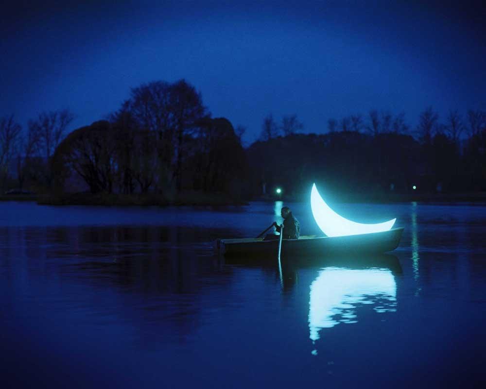 I cross the dark river / to the high bank / where the lunar evergreens grow