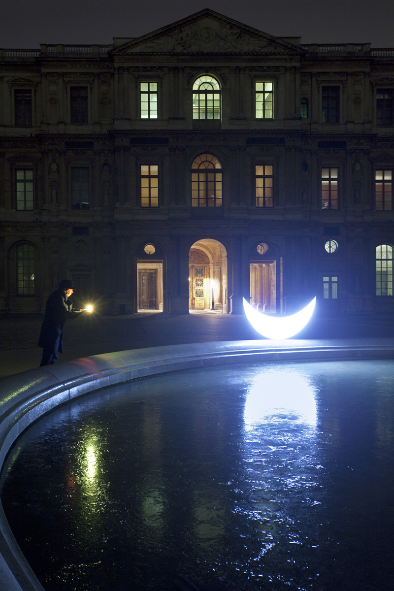 Louvre at night. The moon has laid a silvery trail across the celestial ice. I'll give her a star found in the yard among rubbish, leaves and discarded memories.